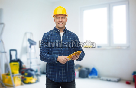 smiling man in helmet with gloves