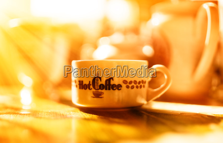 morning coffee with light leak bokeh