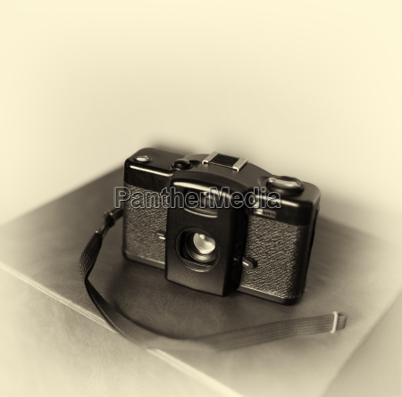 vintage camera with strap bokeh background