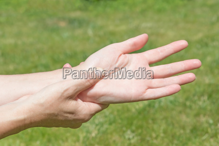 woman showing hands pain