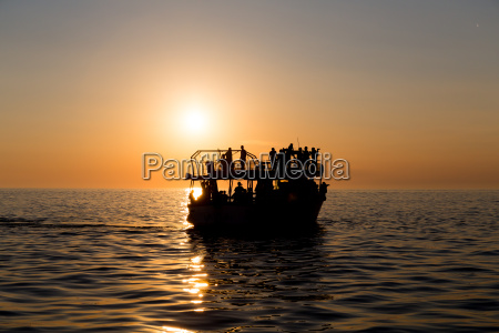 ferry boat silhouette with passengers