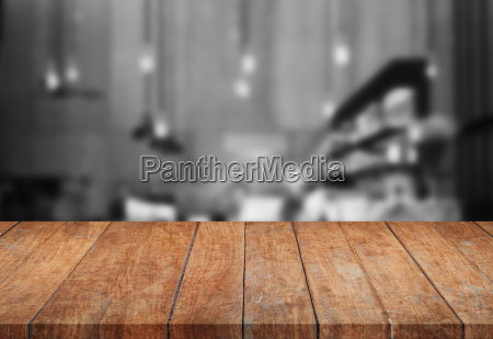perspective wooden tabletop with black and