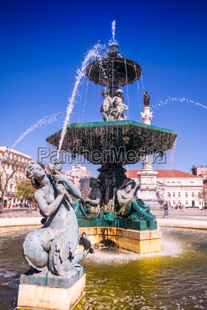 rossio square with fountain located at