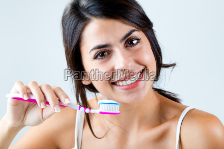 beautiful young woman picking his teeth