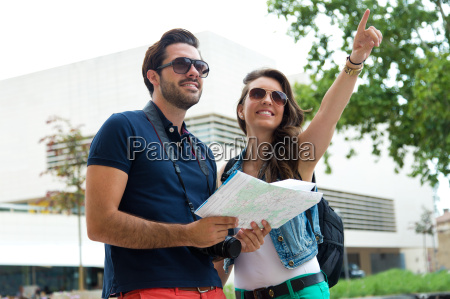 young tourist couple use their map