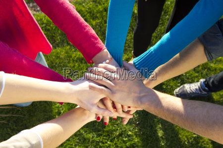 group of friends pile up hands