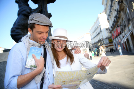 couple visiting madrid and checking on