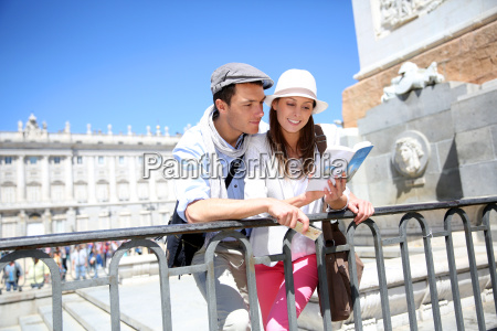 couple reading traveler book by the
