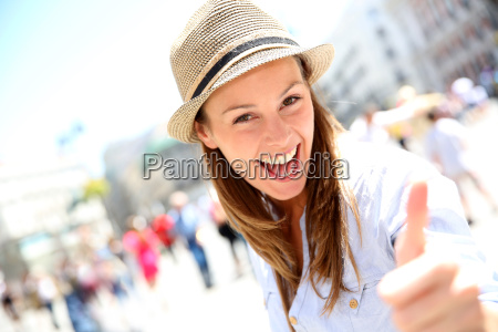 portrait of cheerful girl in town
