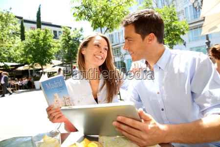 couple connected on digital tablet in