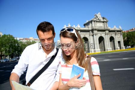 tourist in puerta de alcala madrid