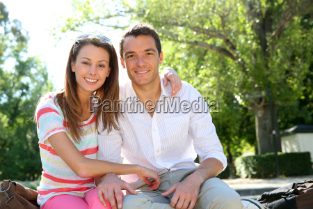 couple in madrid relaxing in retiro