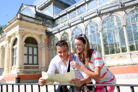 tourists in madrid retiro park by