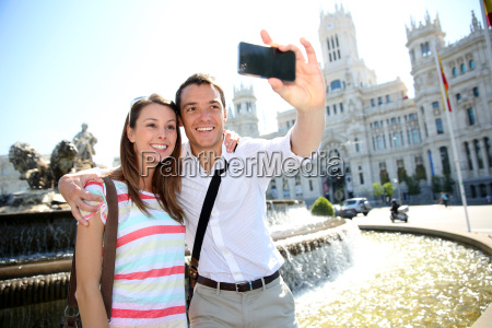 couple taking pictures in plaza de