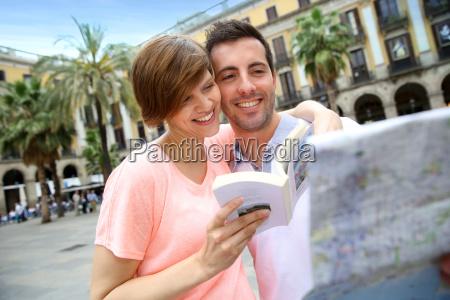 tourists reading map in the plaza