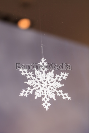 gold silver christmas ornament hanging from