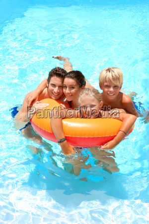 upper view of family in swimming