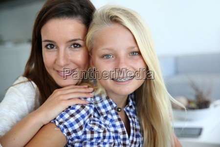 portrait of young woman with teenager