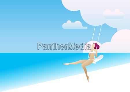 woman riding a swing