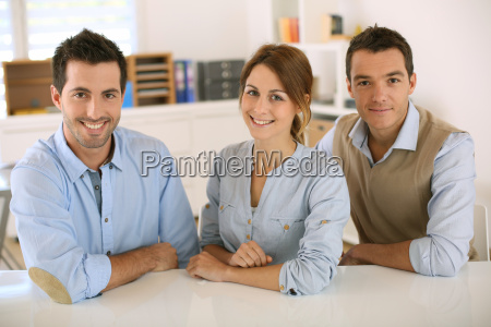 business team sitting at desk in