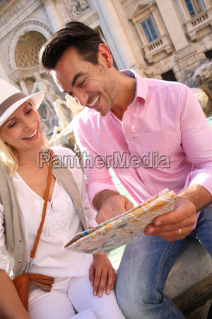 couple reading city map by the