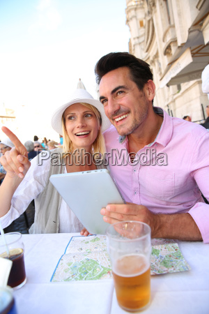 tourists in rome using tablet while