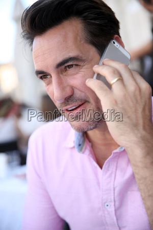 portrait of mature man using smartphone
