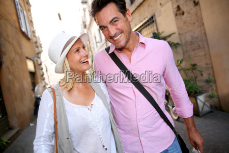 cheerful couple walking on the streets