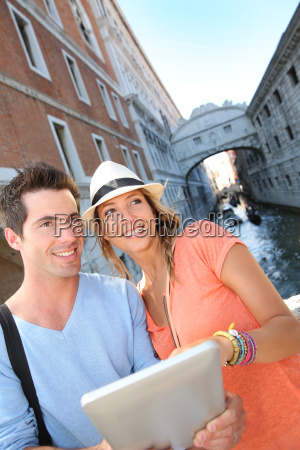 couple looking at tourist guide by