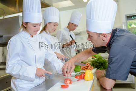 chef guiding trainee