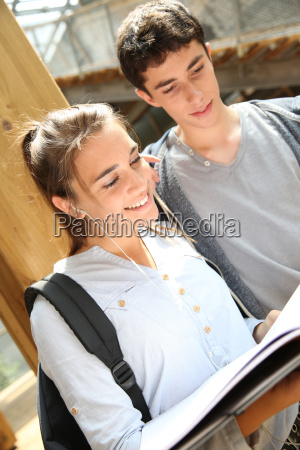 friends studying together in school campus