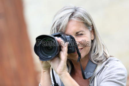 portrait, of, mature, woman, shooting, with - 17805160