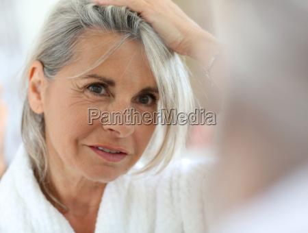 senior, woman, worried, by, hair, getting - 17805798