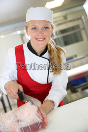 portrait of smiling young butcher girl