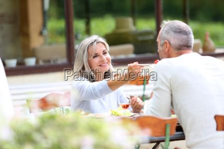senior people having lunch in garden