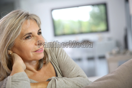 mature woman relaxing at home in