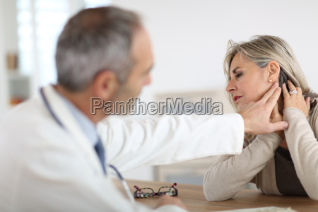 senior woman feeling neck pain