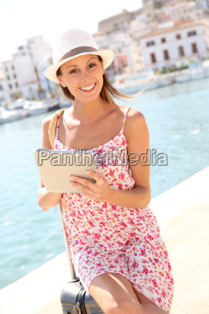 beautiful girl looking at city map