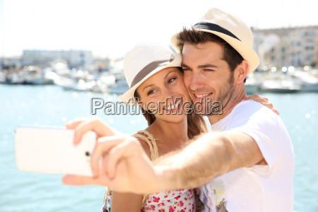happy couple of tourists taking pictures
