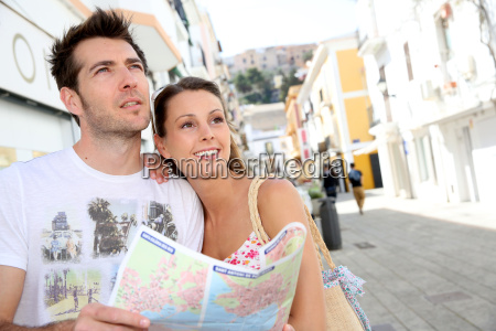 couple visiting the streets of old