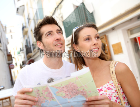 couple of tourists visiting city street