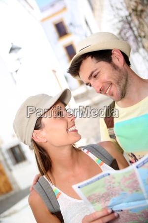 happy couple visiting typical mediterranean village