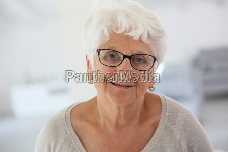 portrait of smiling elderly woman with