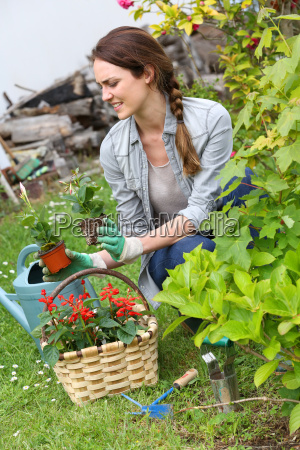 cheerful woman gardening at home in