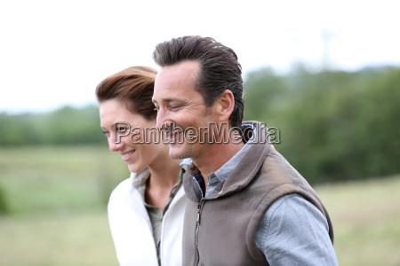 cheerful 40 year old couple walking