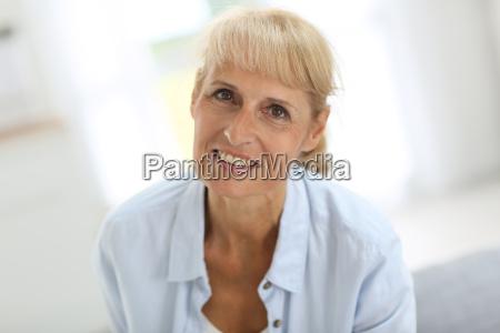 portrait of smiling senior woman at