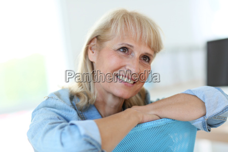 senior woman in office working on