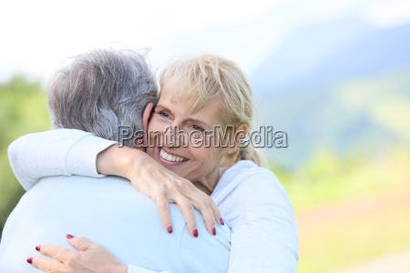 portrait of smiling senoir woman embracing