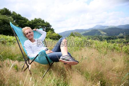 senior woman relaxing in chair in