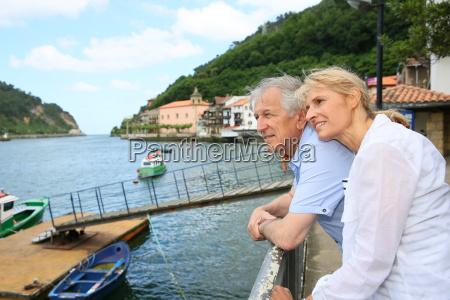 senior couple visiting northern spanish town